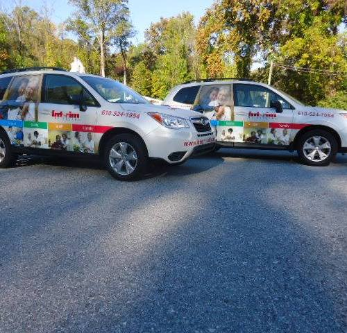 Interim Healthcare partial vehicle wrap with lettering and window wrap