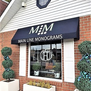 Main Line monograms custom branded shed awning