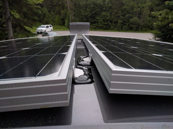 Solar Panels Installation, sealing the brackets