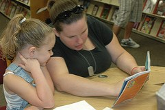 Mentor Reads to Child