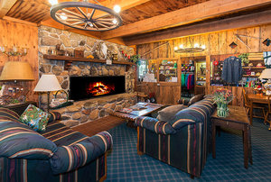 Greenhorn Creek Guest Ranch living room with fireplace.