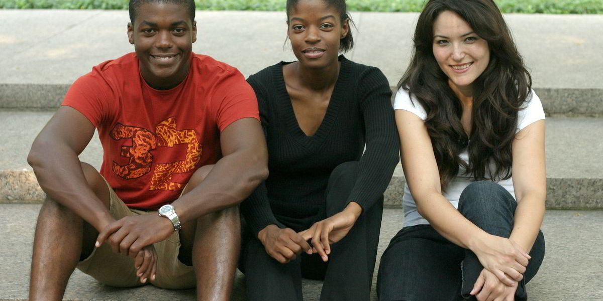A photo of three adolescents sitting side-by-side on long, stone steps. This photo is used as a primary banner image representing the Flint Adolescent Study.