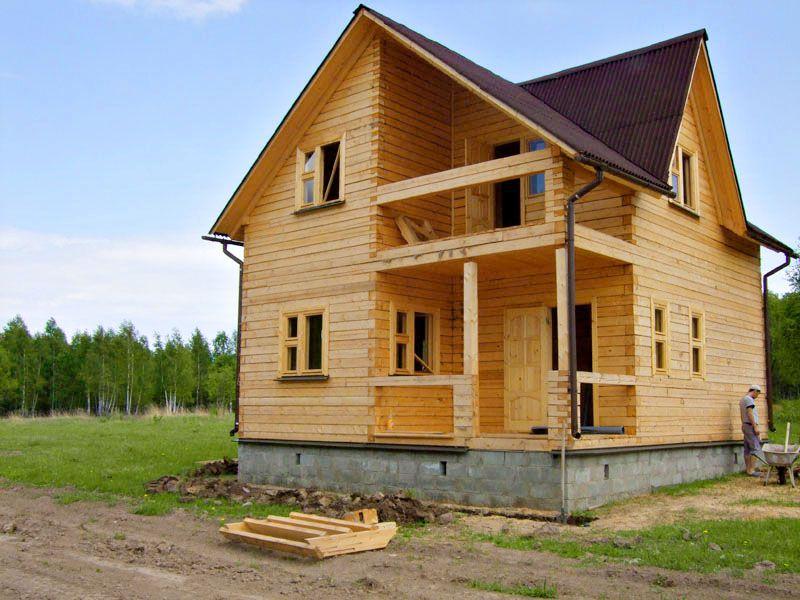 На фото дом из бруса до утепления