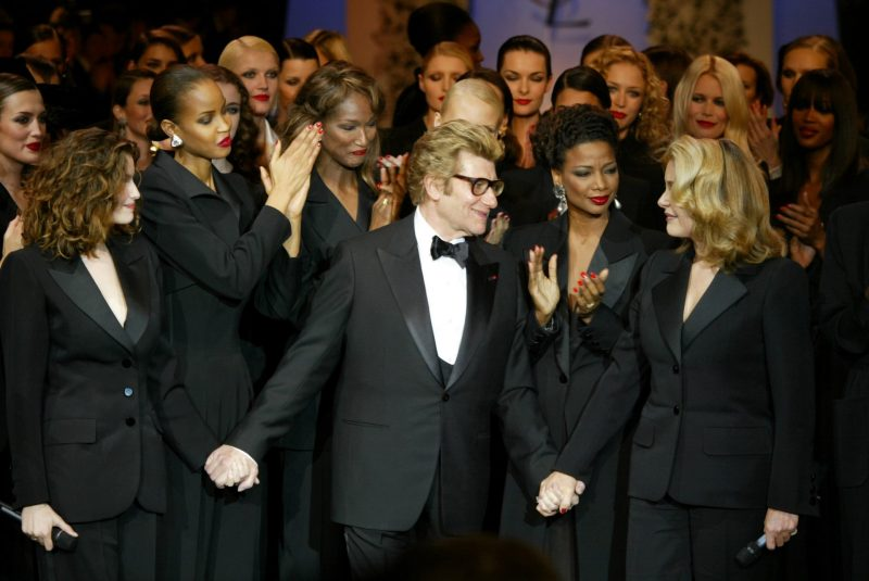 Yves Saint Laurent with Models Laetitia Casta, Catherine Deneuve and More All Dressed in Tuxedoes for the Last Fashion Show 2002