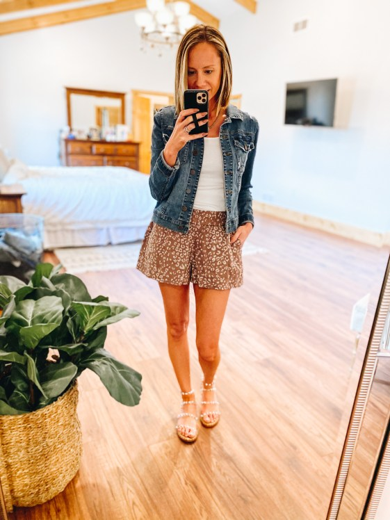 Top 7 Cute Spring Sandals for Women featured by top Pittsburgh fashion blogger, Fashionably Late Mom.  Spring Sandals by popular Pittsburgh fashion blog, Fashionably Late Mom: image of a woman wearing a denim jacket, white top, and leopard print shorts with clear strap studded sandals.