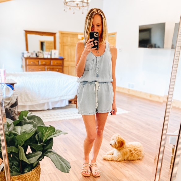 Pink Lily Boutique Favorites for Spring and Summer featured by top Pittsburgh fashion blogger, Fashionably Late Mom |  Pink Lily Boutique by popular Pittsburg fashion blog, Fashionably Late Mom: image of a woman wearing a Pink Lily Boutique chambray romper with studded strap slide sandals.