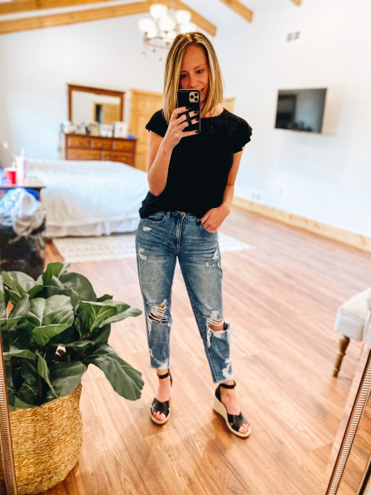 4 Favorite Pairs of Non Skinny Jeans for Women featured by top Pittsburgh mom fashion blogger, Fashionably Late Mom   Non Skinny Jeans by popular Pittsburgh fashion blog, Fashionably Late Mom: image of a woman wearing a black t-shirt, non skinny jeans, and black espadrilles.
