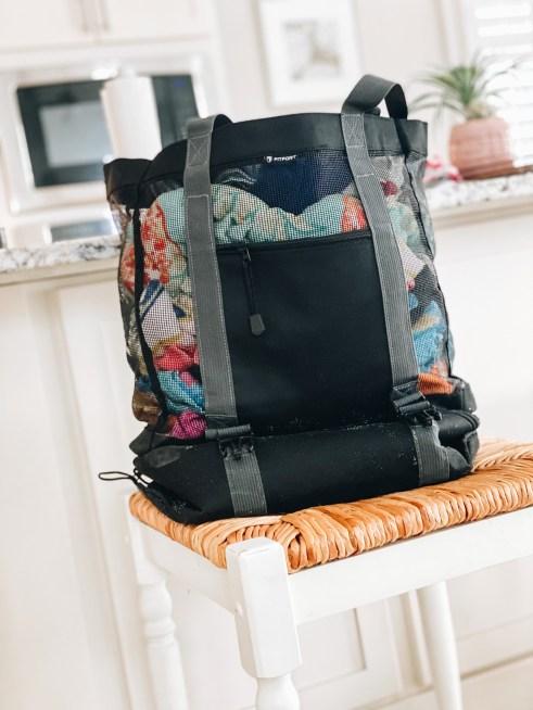 cute beach bags, mesh beach bag, extra large pool bag | Cute Beach Bags by popular Pittsburgh fashion blog, Fashionably Late Mom: image of a black mesh beach bag.