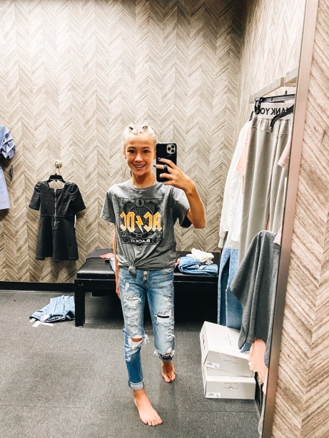 Nordstrom Anniversary Sale 2021: Try On Edition featured by top Pittsburgh fashion blogger, Fashionably Late Mom   Nordstrom Anniversary Sale by popular Pittsburgh fashion blog, Fashionably Late Mom: image of a teenage girl wearing a Nordstrom AC/DC t-shirt and distressed jeans.