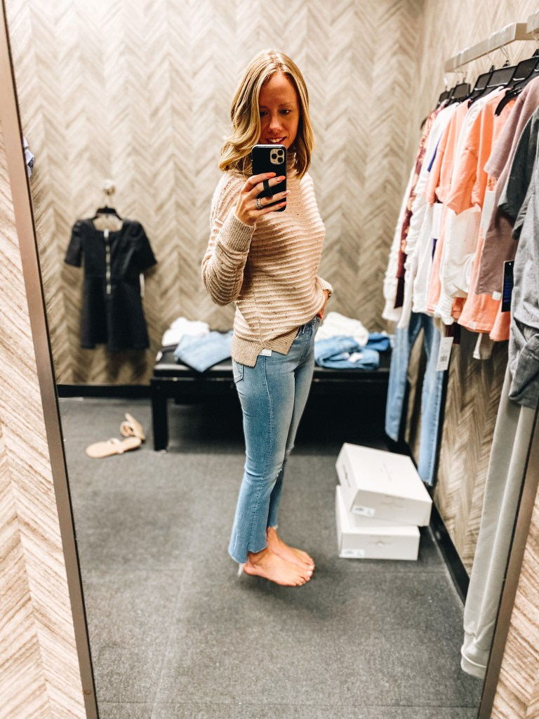 Nordstrom Anniversary Sale 2021: Try On Edition featured by top Pittsburgh fashion blogger, Fashionably Late Mom   Nordstrom Anniversary Sale by popular Pittsburgh fashion blog, Fashionably Late Mom: image of a woman wearing a Nordstrom tan and brown stripe sweater and light wash ankle jeans.