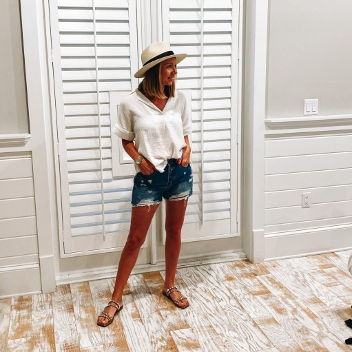 white linen top, distressed shorts, studded sandals, vacation outfits, 30A packing list, what to wear on vacation   30A Packing List by popular Pittsburgh life and style blog, Fashionably Late Mom: image of a woman wearing a white linen top, distressed shorts, straw fedora hat, and brown studded strap sandals.