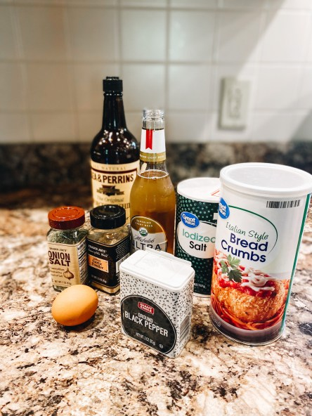 meatloaf recipe ingredients, dinner ideas | Sweet and Spicy Meatloaf by popular Pittsburgh lifestyle blog, Fashionably Late Mom: image of onion salt, a brown egg, black pepper, Italian Style bread crumbs, Iodized salt, bottle of beer, and Lea and Perrins Worcestershire sauce.