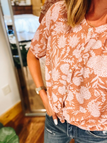 Working Mom Outfits by popular Pittsburgh fashion blog, Fashionably Late Mom: image of a woman wearing a fall floral crop top and distressed jeans.