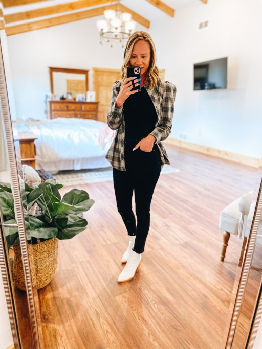 fall style, black denim, womens flannel top | Gibson Clothing by popular Pittsburgh fashion blog, Fashionably Late Mom: image of a woman wearing a black top, black pants, white ankle boots, and black and cream plaid shirt.