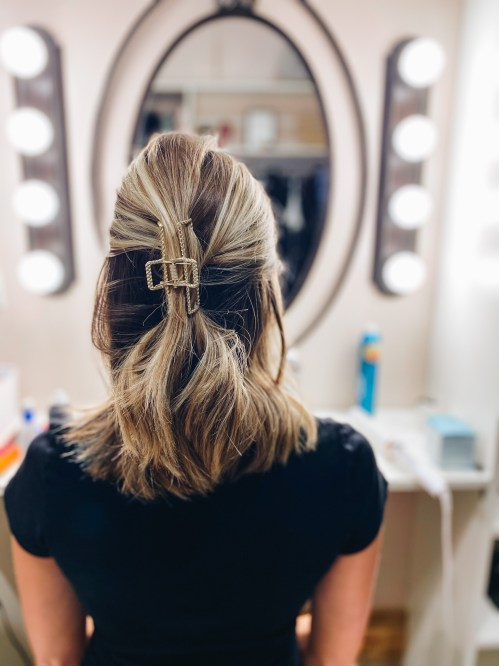 half up claw clip hairstyle   Claw Clip Hairstyles by popular Pittsburgh fashion blog, Fashionably Late Mom: image of a woman with a half up claw clip hairstyle.