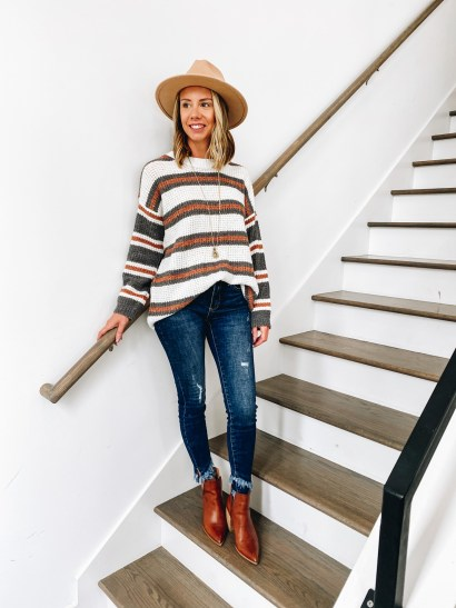 fall sweater, fall fashion, pink lily autumn awaits collection, brown booties   Pink Lily by popular Pittsburgh fashion blog, Fashionably Late Mom: image of a woman wearing a Pink Lilly striped sweater, tan felt fedora hat, distressed jeans, and brown ankle boots.