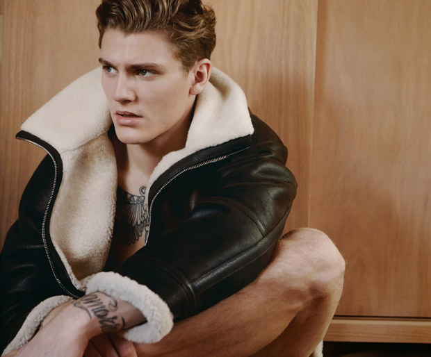 Luxe Signature-Spotlighting another fall-winter 2014 collection, photographer Milan Vukmirovic shoots model Mikkel Jensen for the latest edition of his men's magazine, Fashion For Men. Wearing fall fashions from French fashion house Louis Vuitton, Mikkel is captured on set with a modest, clean location serving as the spread's background. From leather outerwear worn against Mikkel's bare tattooed skin to a tailored double-breasted jacket, the shoot showcases a minimal view at the luxurious fashion label.