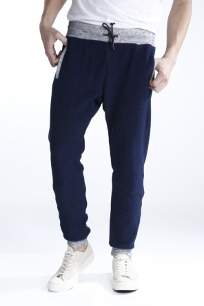 Jogger pants have become the normcore staple in men's wear. Fashion brands have embraced the trend and incorporated sports-inspired pieces, fusing luxury and athleticism in creating this hybrid sweatpant-trouser. The elastic cuffs combine the comfort and formality of an everyday trouser. By Frederick Marfil.