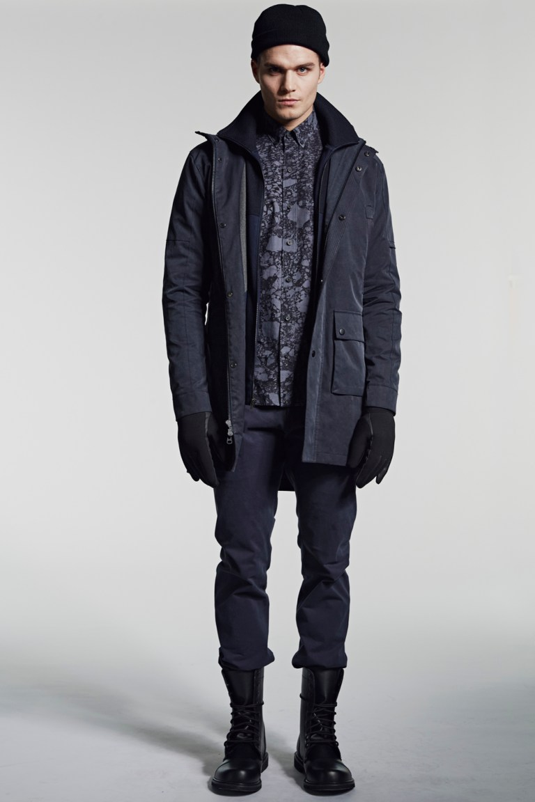 Every season W.R.K is inspired by a different occupation and the man who holds it. This season W.R.K designer Matteo Gottardi was inspired by the Anchorage Alaska SWAT, their rigorous lifestyle, and stringent physical agility.   The collection incorporates technical elements of the SWAT uniform: mesh, ottoman stitch and grosgrain fabrications. Every detail is derived from their uniform: structured and tailored blazers, hoodies and rigid silhouettes. Also present in the collection are W.R.K's signature construction such as reinforced seams and articulated sleeves that serve a purpose to the elite force but also appeal to the man passionate about well-crafted clothing.   Literal fabrications such as neoprene, waterproof zippers and quilting are part of the vocabulary for the season. Gottardi lines outerwear in the collection with fleece for durability and comfort. Additional layers of fabric represent the padding of the uniform and the protection needed to carry out an officer's duty.   W.R.K's color palette for the season is a mixture of dark gray, black and tonal blue that remind us of the predominantly dark, arctic environment, juxtaposed by snow whites and reds and purple mountains majesty. The geographical prints reflect the distinctive arctic landscape; through the depths of the mountains, aerial views of the mountain peaks and glaciers in black on white and vice versa.   The overall mood is dark, at times aggressive, just like the elite force, which is stern, masculine and unapologetic. It is W.R.K.