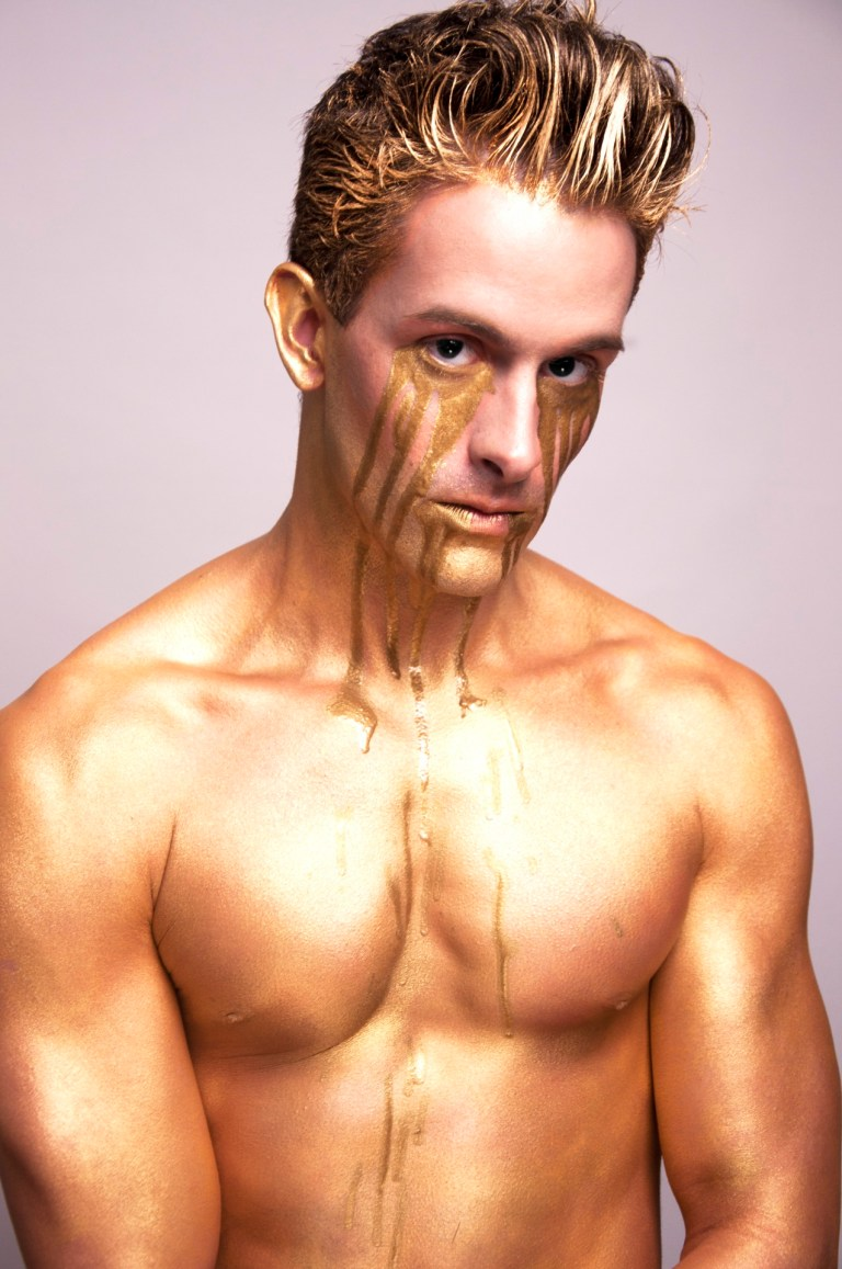 Gold the recent work by Photographer Roberto Araujo featuring Ian Campayno modeling and exposing his beautiful body painting by Boomie Gee.