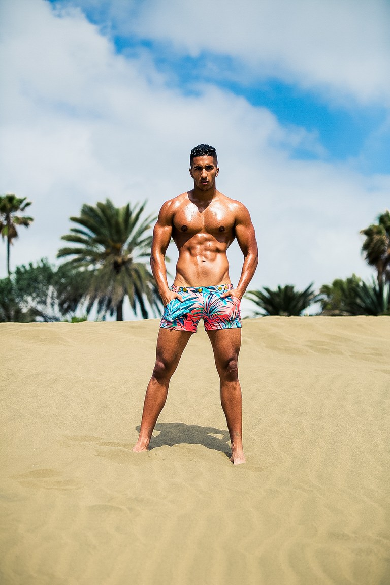 Shooting at Maspalomas Dunes, Spain. Photographer Adrián C. Martín and model Karim Gasmi posing with famous American label Charlie by Matthew Zink.