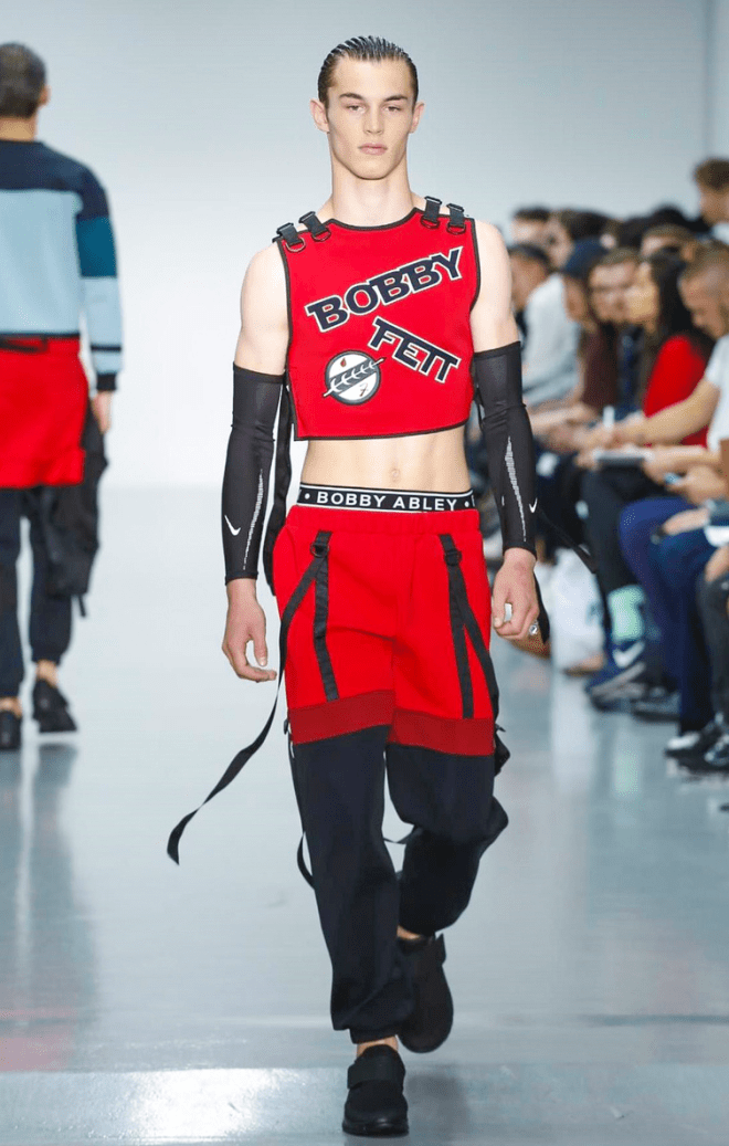 Bobby Abley a revolutionary fashion designer he made it again at London Collection Men, for his Menswear he added and designed a really colourful and dynamic sportswear line. Cropped tops, running joggers are the best in line.