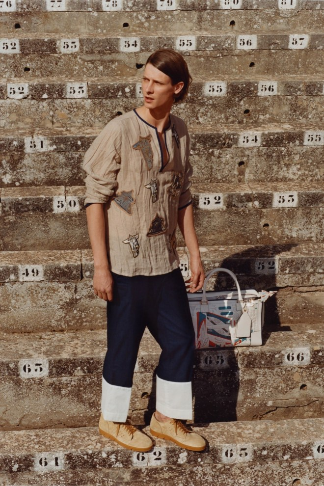 """""""I want luxury to be fun,"""" Jonathan Anderson said during a tour of his spring men's collection for Loewe, which he loaded up with cartoonish elements ranging from manga patches to an image of Goofy twisted up on the pitcher's mound."""