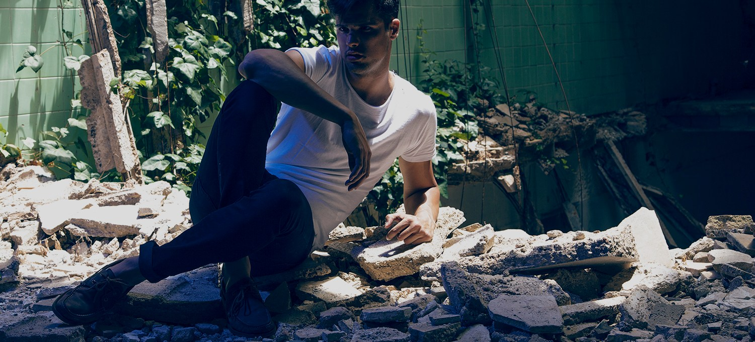 Photo shoot with Spanish new model Ruben Llorens captured by Jose Martinez, styled by Antonio Bordera, in an abandoned factory, an apocalyptic theme.