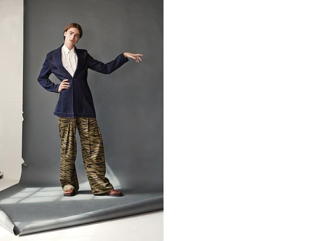 White ruffle shirt: Vintage Moschino (stylists own) Denim coat: Alex Mullins Khaki tiger print trousers: Asger Juel Larsen Brown square toe shoe: Rokit Vintage