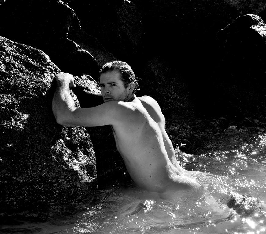 """Striking American model Jake Jensen is """"Water Boy"""" in the new beach session captured by Rick Araujo. Jake is wearing swimwear by 2XIST."""