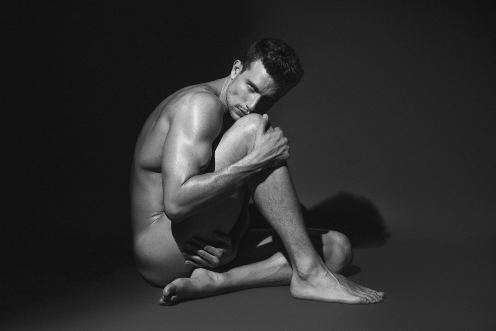 """Posing for a stunning eye-catching studio session by photographer Johnny Lopera we present entitled work """"Light & Shadow"""" featuring male model Juan Pablo Mejía from New Icon Management. Grooming by Antonio Ruz."""