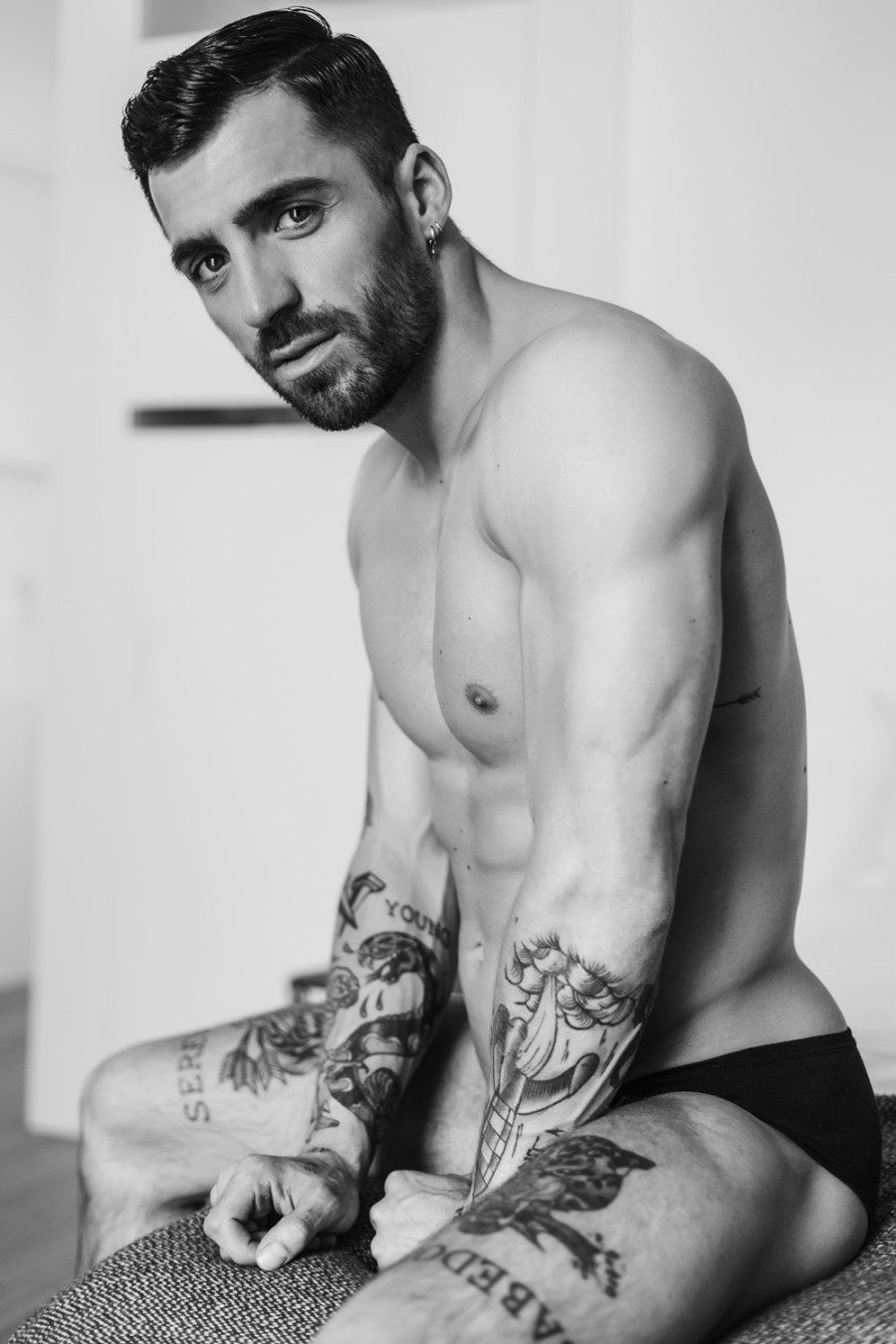 "You'd better looking for where I've got the word ""Serenidade"" is tattooed on the beauty firm toned body of male model João Pombeiro photographed by David Velez."