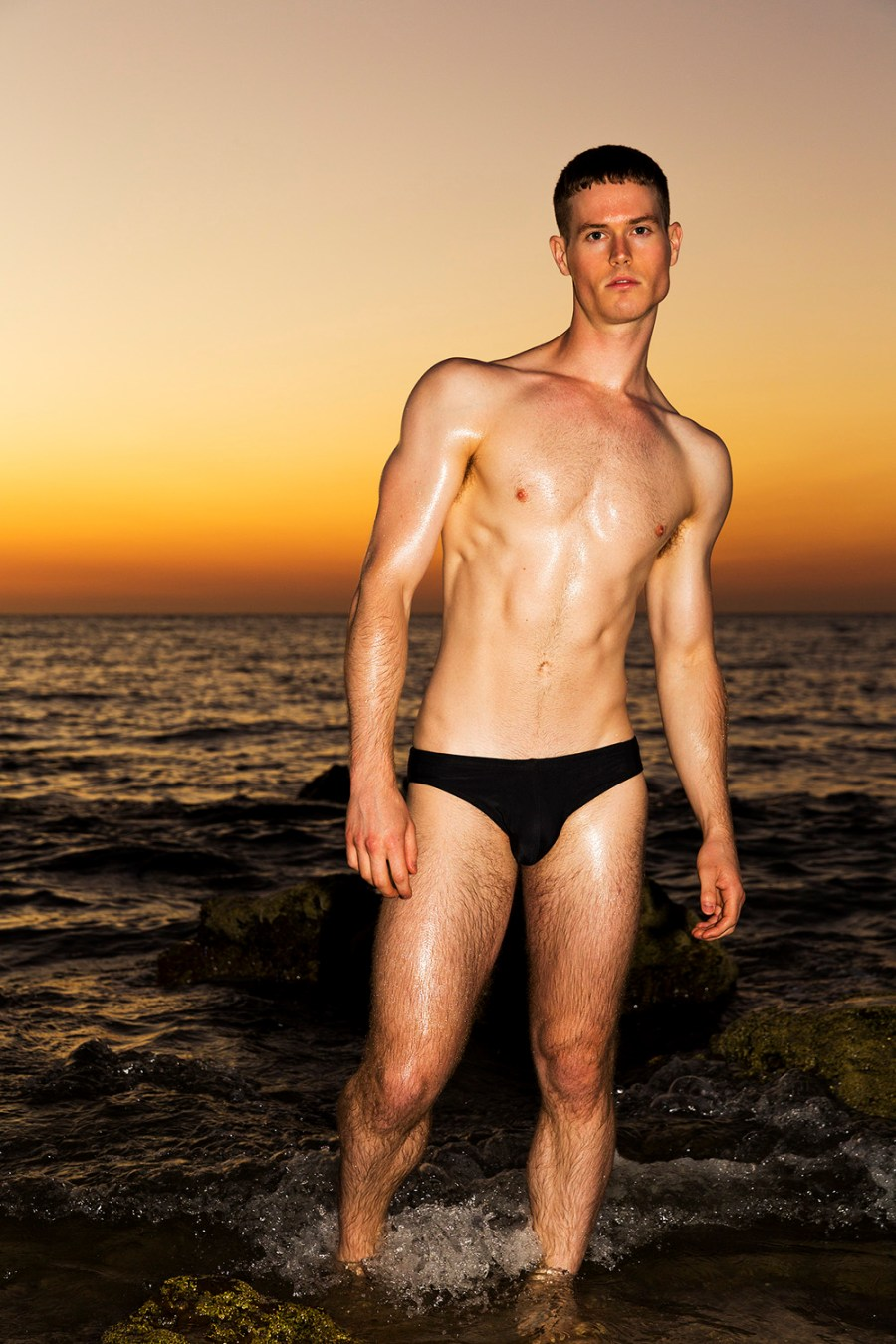 Let's meet this work of talented photographer Trent Pace featuring in exclusive for Fashionably Male model Matthew Harden in a beach paradise theme background where we can appreciate the real talent of Trent and Matthew. who's wearing black swim briefs by Cocksox and white briefs by Teamm8.