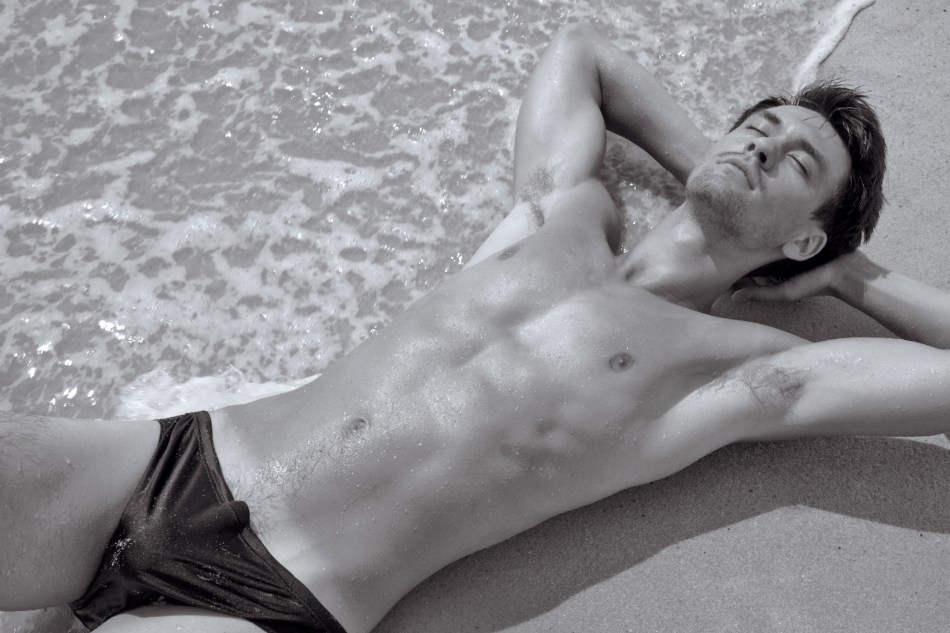 The dog days of summer just got hotter in this new photo shoot of Gabriel Vaughn by Stefan Mreczko. Recently shot on Fire Island, this Gabriel & Stefan collaboration reminds us what summer sizzle is all about. Gabriel has been modeling for about five years. He is originally from Columbus, Ohio where he worked with such brands as Ray Bans and Alternative Fashion Mob. Gabriel clearly has stamina and nerves of steel as he teaches 3rd grade in a Manhattan, NY elementary school. Our model/teacher enjoys the gym and Nintendo Wii U in his free time.
