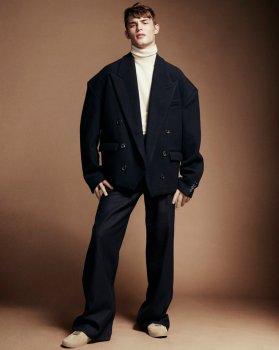 Dries Van Noten wool turtleneck and trousers; Juun.J wool coat.