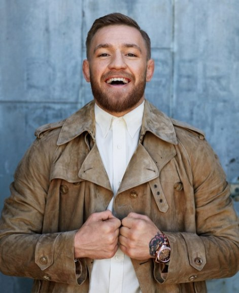 Coat, shirt by Ralpha Lauren / Watch by Rolex