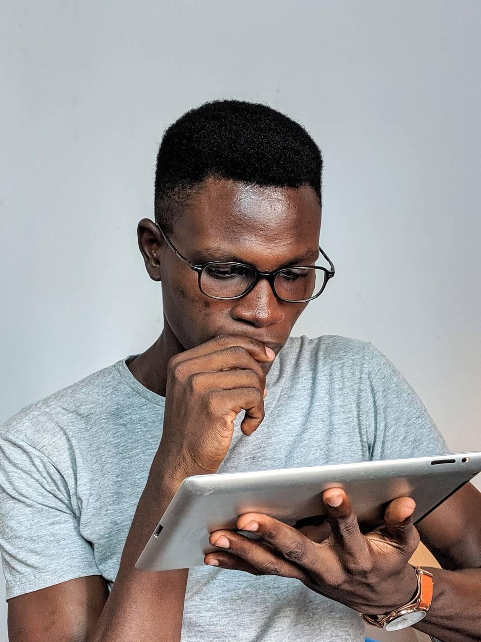 man looking at ipad pro