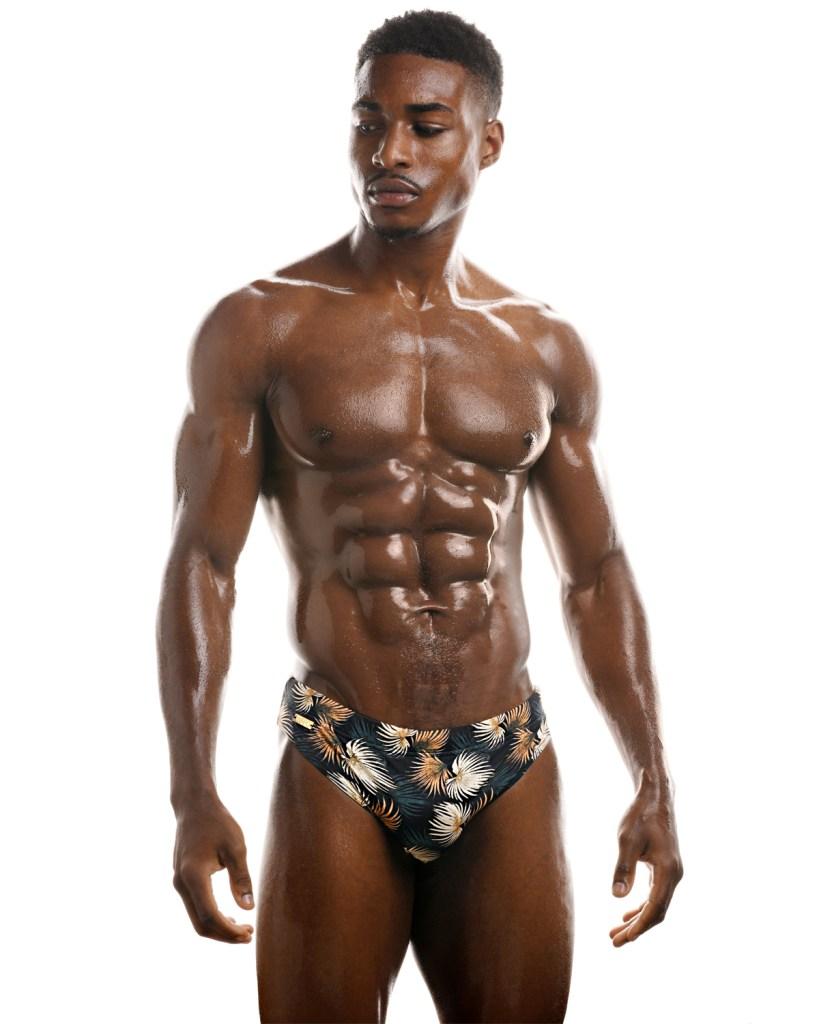 Professional boxer Idris Virgo wears selection of hot swimwear designs by WAPO