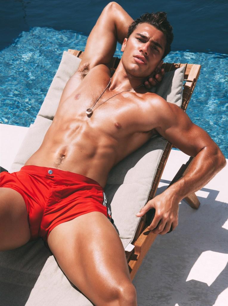 Model Deano Perona rest in a beach chair by Christian Oita  for #D2BEACH Swimwear