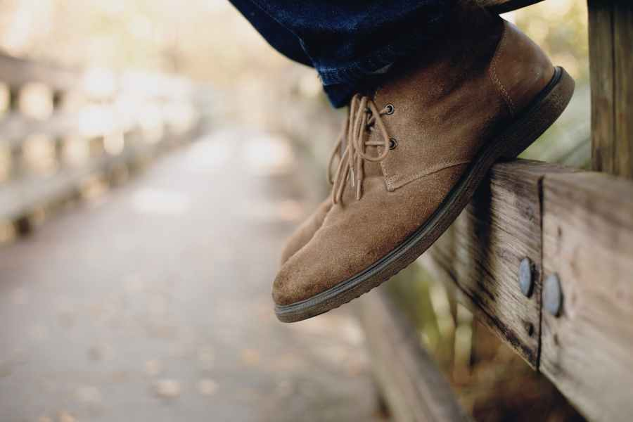 close up photo of person wearing brown boots