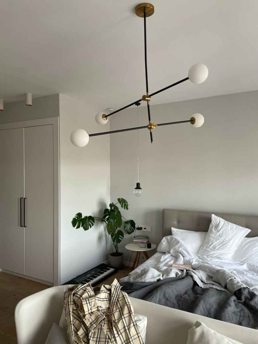 interior of bedroom with unmade bed in morning. Stylish Outfit Inspiration to Stay Fancy All Year Round