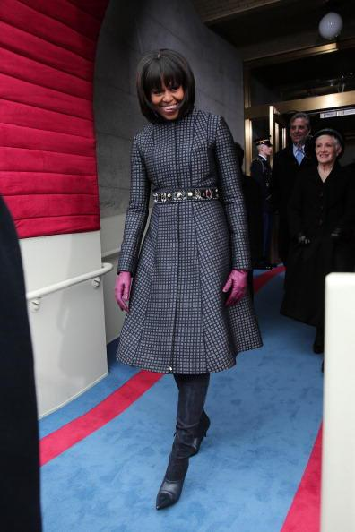 Michelle Obama kept on her Thom Browne coat for the Second Inaugural Speech, but added J.Crew gloves and belt, and Reed Krakoff boots.