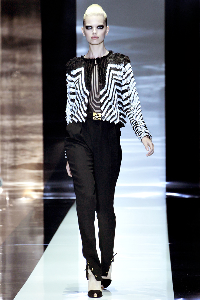 gucci spring 2012 Beyonce's Mrs. Carter Show Gucci Custom Black and White Beaded Top and White Pants 1