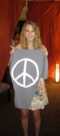 Taylor-Swift-WEARING-PEACE-LOVE-WORLD-in-top-20-style-icons-of-2010-on-fashiondailymag