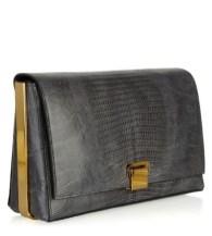 the ROW metal framed lizard clutch on FashionDailyMag