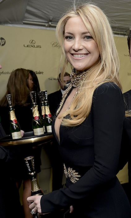 Kate Hudson enjoys Moet & Chandon champagne at the Harvey Weinstein after party to the Golden Globes. Credit Michael Kovac