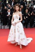 "Liu Yifei attends the ""Cafe Society"" premiere and the Opening Night Gala during the 69th annual Cannes Film Festival"