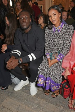 LONDON, ENGLAND - SEPTEMBER 16: Stormzy (L) and Maya Jama wearing Burberry at the Burberry September 2017 at London Fashion Week at The Old Sessions House on September 16, 2017 in London, England. Pic Credit: Dave Benett
