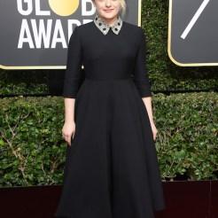 Elisabeth Moss in dior at 75th golden globes fashiondailymag
