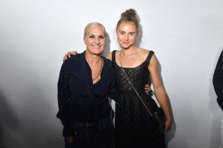 PARIS, FRANCE - SEPTEMBER 24: Maria Grazia Chiuri and Margo Hayes pose backstage after the Christian Dior show as part of the Paris Fashion Week Womenswear Spring/Summer 2019 on September 24, 2018 in Paris, France. (Photo by Victor Boyko/Getty Images) *** Local Caption *** Maria Grazia Chiuri; Margo Hayes